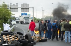 Channel Tunnel chaos as protesters burn tyres on train tracks