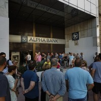 People are queuing for ATMs in Greece - but they can only get €60
