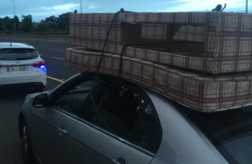 Driver caught on M50 with bed on roof, holding rope in their hands