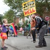 A little girl defiantly held a rainbow flag throughout a preacher's anti-gay rant