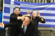 Alexis Tspiras throws feta cheese and Greek yoghurt at Michael Noonan outside Leinster House*