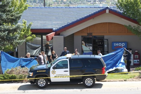 Officials investigate the scene of a shooting in an IHOP restaurant in Carson City, Nevada yesterday.