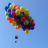 Man takes to the sky in deck chair suspended by 120 balloons