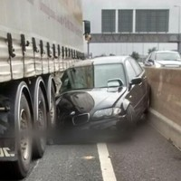 Remarkably, no-one was hurt when this car was crushed by a truck