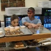 Ariana Grande has apologised after she was filmed licking doughnuts and saying she hates America