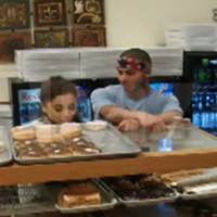 Ariana Grande apologises after being filmed licking doughnuts and saying she hates America