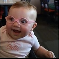 The internet can't cope with this baby girl trying on her glasses for the first time