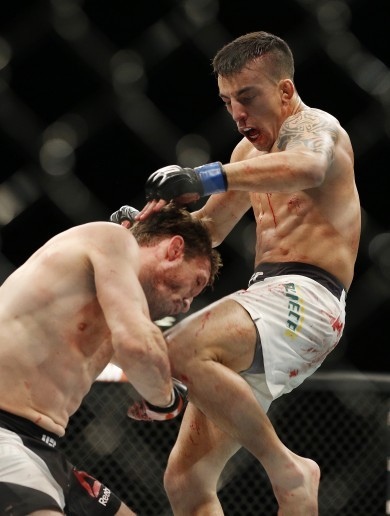 Thomas Almeida nearly decapitated Brad Pickett with a flying knee tonight