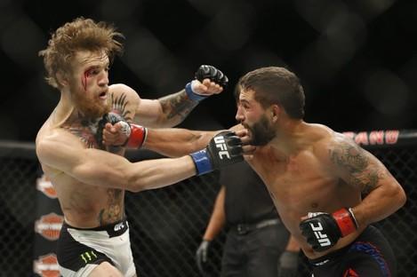 McGregor and Mendes during Saturday's interim title fight.