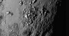 """A giant surprise"": New photos reveal previously unseen mountains on Pluto"