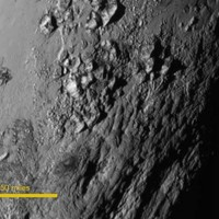 """""""A giant surprise"""": New photos reveal previously unseen mountains on Pluto"""