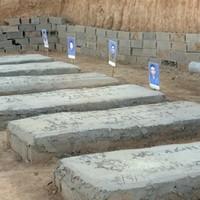 Libyans find mass grave, bodies of slain detainees