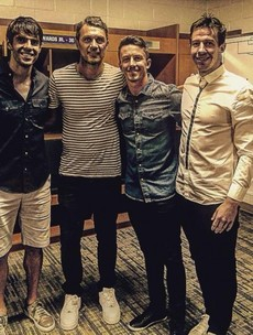 Sean St Ledger pictured with a couple of unidentified fans after Orlando's game last night