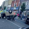 Main Street reopens in Bray after car flips onto roof