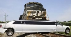 Watch the dramatic moment a freight train smashed into a limo