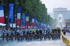 Paris police open fire on car that tries to crash through Tour de France barricade