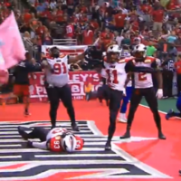 American football team celebrate with a glorious recreation of 'The People's Elbow'