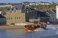 Father and son rescued after being swept away in dinghy