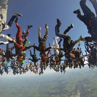 PHOTOS: 164 skydivers join hands for world record at 20,000 feet