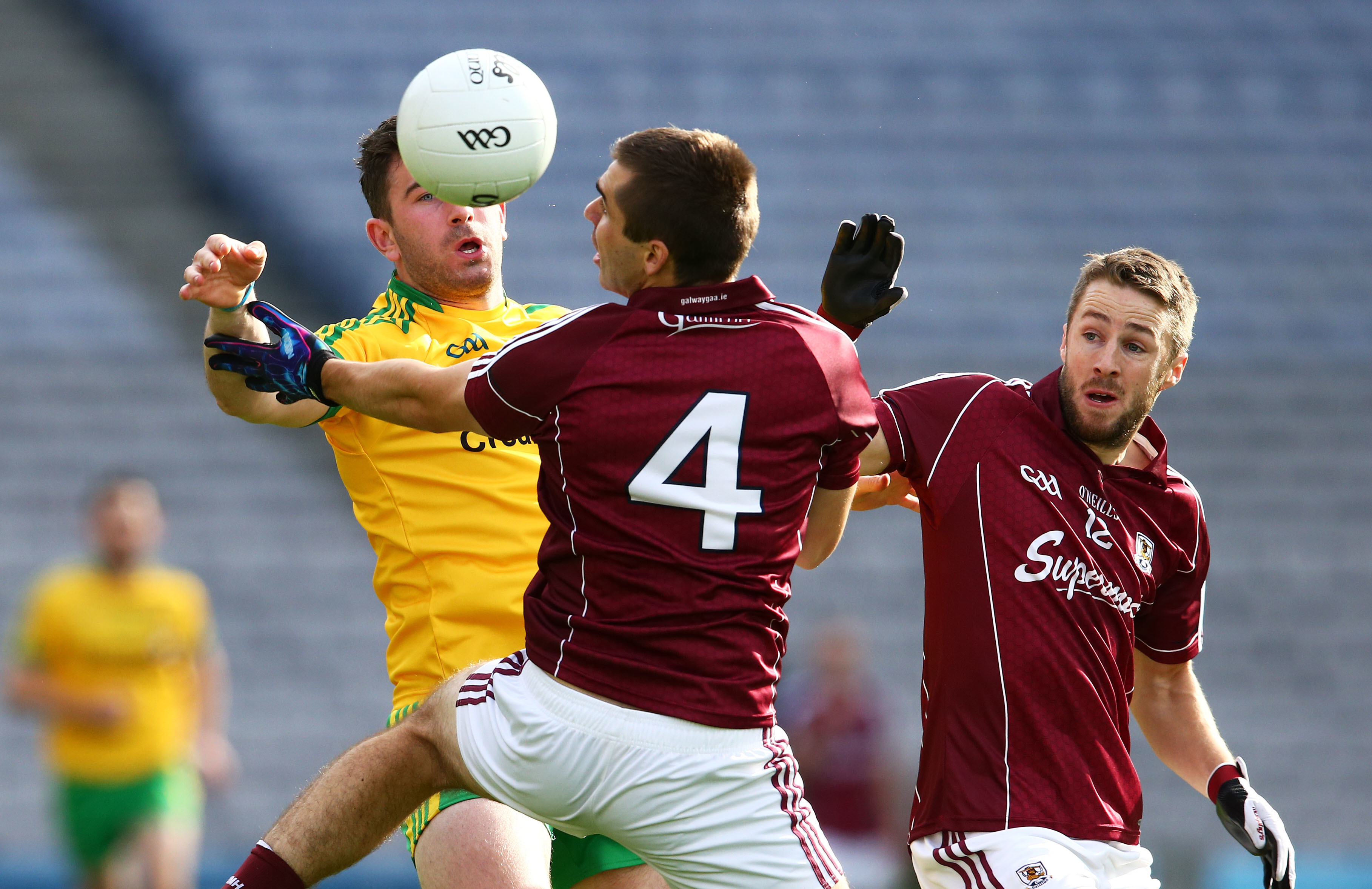 Patrick McBrearty under pressure from Cathal Sweeney and Micheal Lundy.