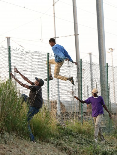 Riot police spray migrants with 'chemical irritant' as hundreds storm Channel Tunnel