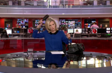 A BBC newsreader was caught brushing her hair, and totally owned it