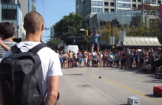 This busker had some harsh words for the kid who tried to knock him down
