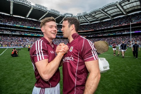 Padraig Brehony and David Collins celebrate Galway's win.