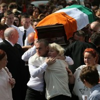 Murdered ex-IRA man laid to rest - as three people are questioned over his killing