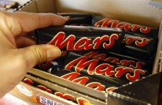 A woman fined for stealing a Mars bar has been given nearly €20,000 to pay it