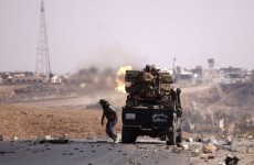 Libyan forces pull back after fierce battles in Gaddafi's hometown