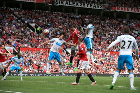 Chris Smalling (centre) sees a late header rebound off the post.