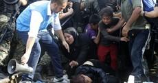 Photos: Hundreds of refugees storm Macedonian border as police hurl stun grenades