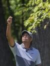 Missed putt on 18 leaves Tiger Woods 2 shots back of Wyndham leader