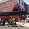 Driver 'critical' and several others injured after bus crashes into building