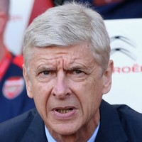 Arsene Wenger hits back at Gary Neville jibe