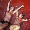 PHOTOS: 20,000 people pelt each other with tomatoes