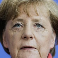Merkel vows zero tolerance for migrant hate - as 55 bodies found on boats