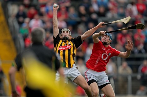 Richie Doyle rises highest in an aerial battle with Cork's Conor Lehane.
