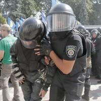 Chaos in Kiev: One killed and dozens injured in clashes outside parliament