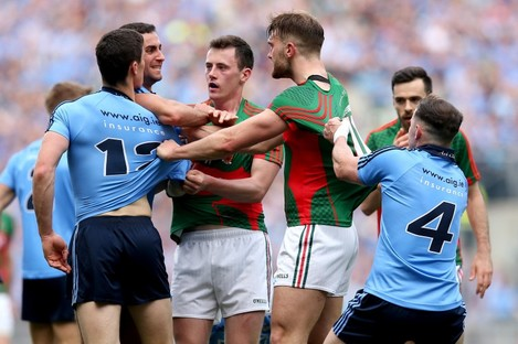 Dublin and Mayo players clash during last week's game.