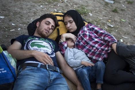 A family sleeps in a park in Belgrade yesterday.