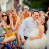 Thousands of naked cyclists photobomb wedding shoot