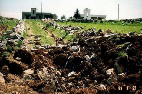 The scene at Green Rooms, Lebanon after the explosion which killed three Irish soldiers. Their truck landed in the field to the left.