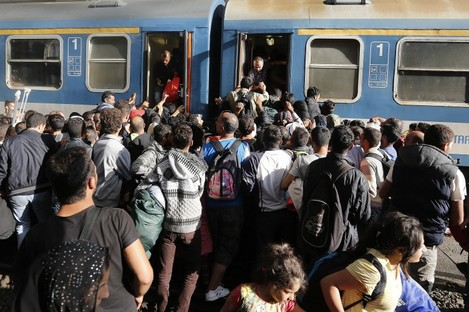 Hundreds of migrants trying to board a train at a station in Budapest, Hungary.