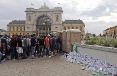 Hungarian football ultras attack refugees at Budapest train station