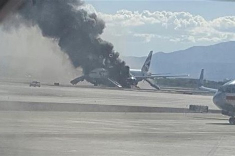 Smoke billows out from the plane at McCarren International Airport.