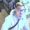 Hipster thief steals six-string guitar from music store