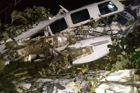 This photo released by the San Predro de los Milagros Fire Department shows the wreckage of a small plane assigned to the crew of a film starring Tom Cruise, that crashed, in a rural place of San Pedro de los Milagros, Colombia.