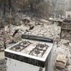 PHOTOS: Wildfires incinerate homes in California